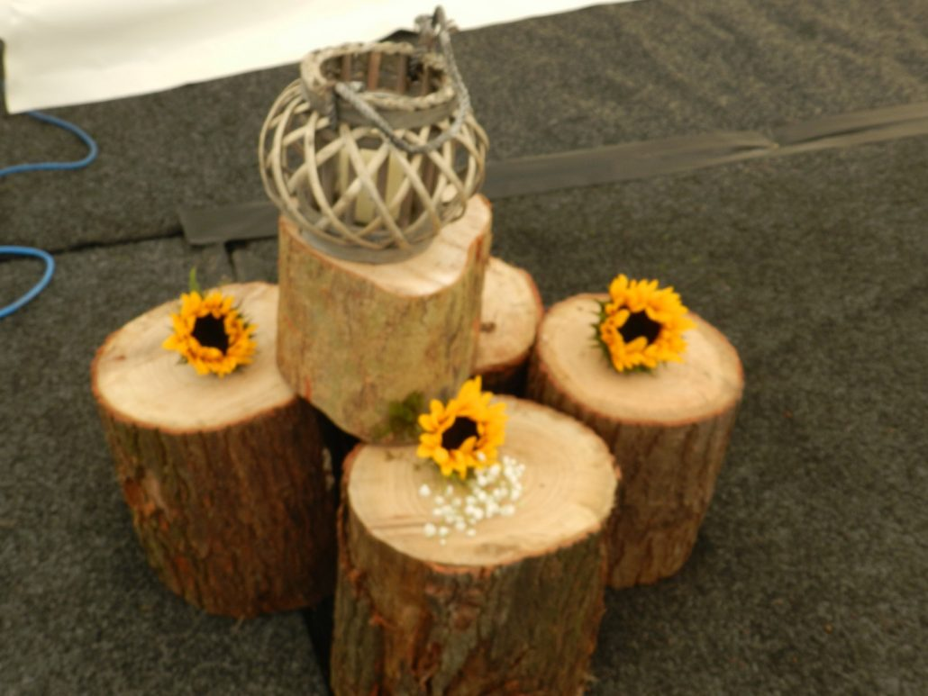 Logs and wicker lantern