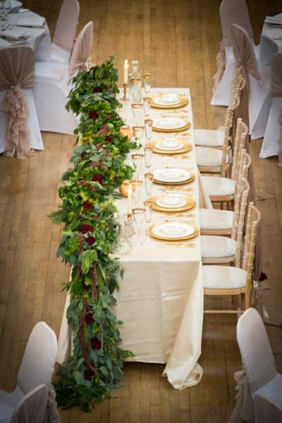Foliage and rose top table garland at Cusworth Hall