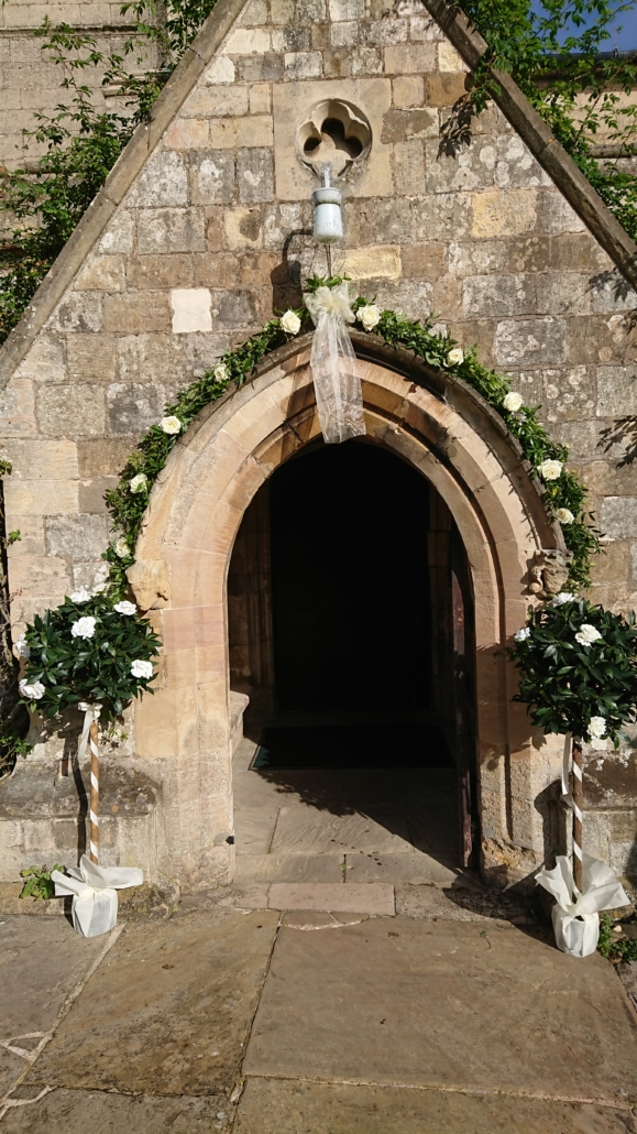 Church entrance arch with bay trees at St Giles Scartho