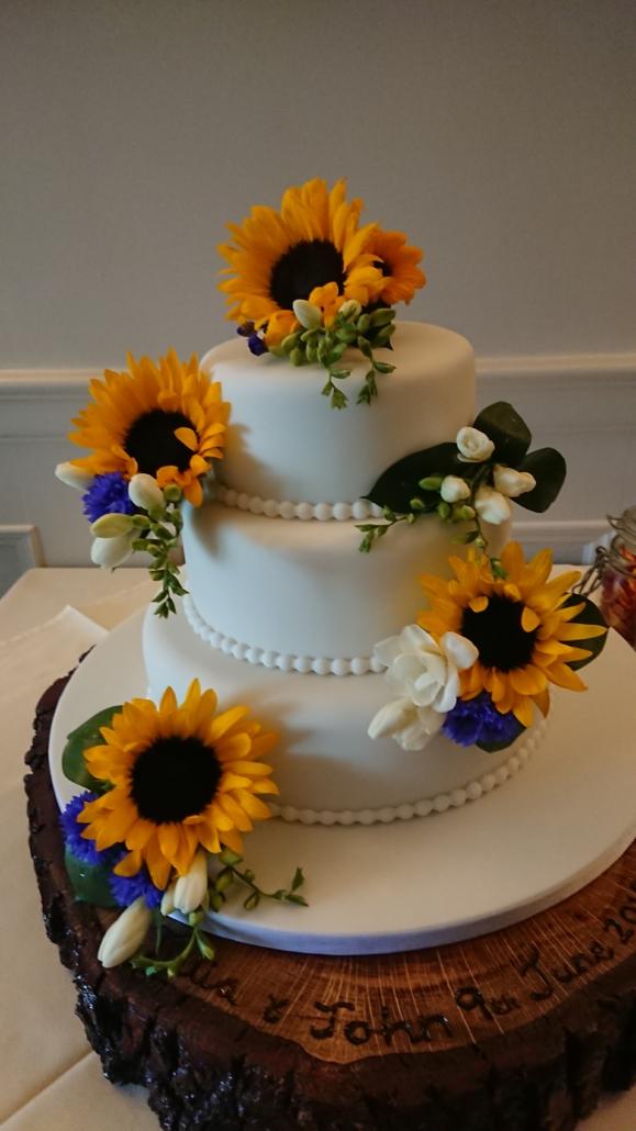 Wedding cake display with sunflowers