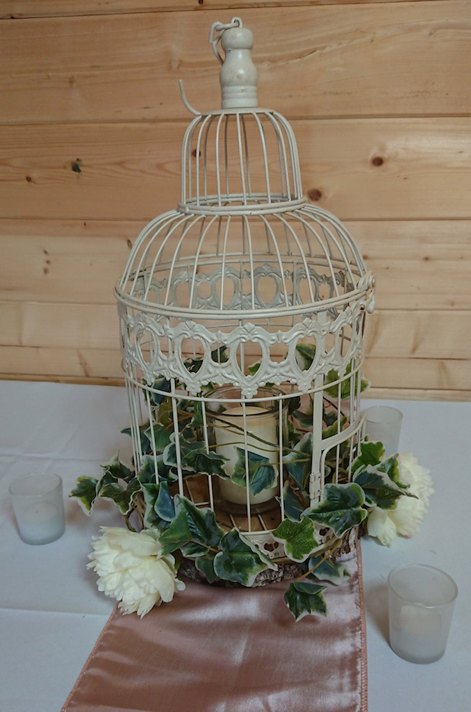 Birdcage with foliage and blooms