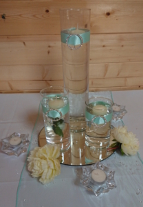 Glass cylinders with floating candles