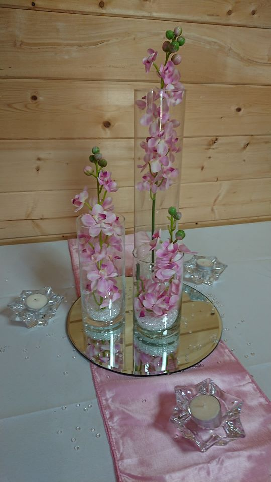 Glass cylinders with orchids